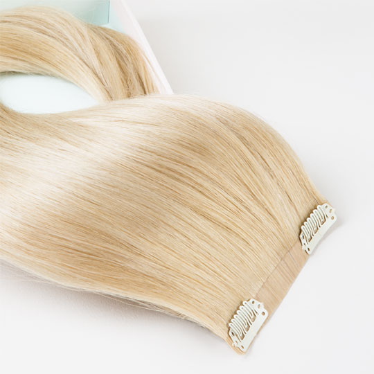 Seamless clip in hair extensions weft